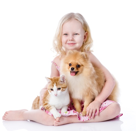 girl playing with pets - dog and cat  looking away  isolated on white background