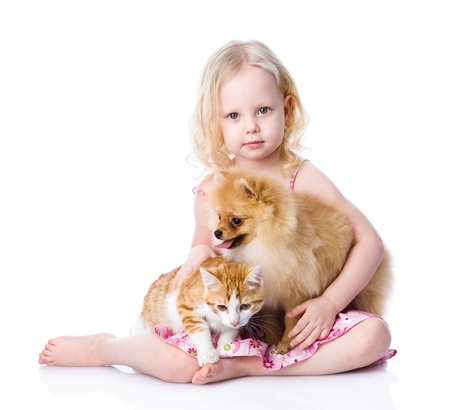 girl playing with pets - dog and cat  looking at camera  isolated on white background
