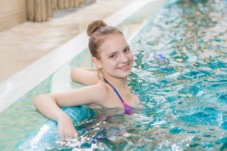 Photo for beautiful teen girl in the pool. - Royalty Free Image