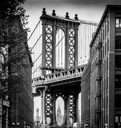 Photo for My attempt at the classic shot of the Manhattan Bridge from Brooklyn.  Cloud and haze made it difficult to get the Empire State Building nice and clearly. - Royalty Free Image