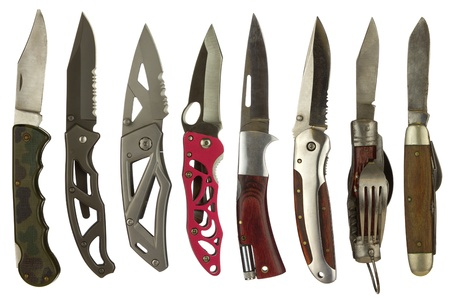 Foto de Knife collage isolated on a white background depicting a variety of pocket knives. - Imagen libre de derechos