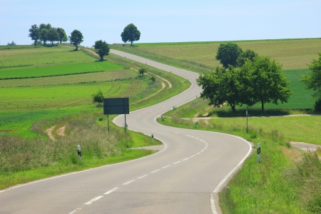 Photo for Curvaceous country road on the Swabian Alb, Baden-Wuerttemberg, Germany - Royalty Free Image