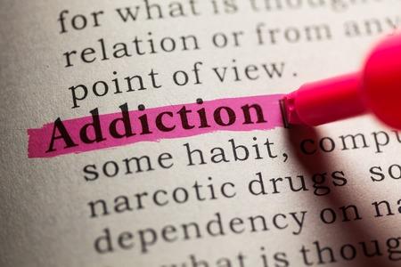 Photo pour Fake Dictionary, definition of the word Addiction. - image libre de droit