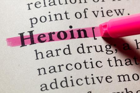 Foto de Fake Dictionary, Dictionary definition of the word heroin. including key descriptive words. - Imagen libre de derechos