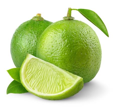 Foto de Fresh limes isolated on white - Imagen libre de derechos