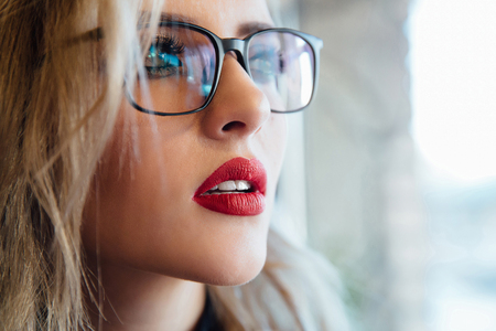 Photo for Close up portrait of a female wearing an eyewear looking to the far distance - Royalty Free Image