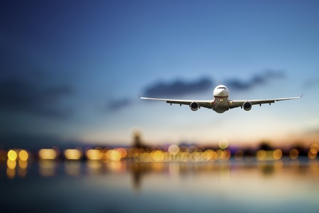 Foto de perspective view of jet airliner in flight with bokeh background - Imagen libre de derechos