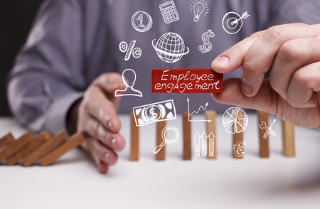 Photo for Business, Technology, Internet and network concept. Young businessman shows the word: Employee engagement  - Royalty Free Image