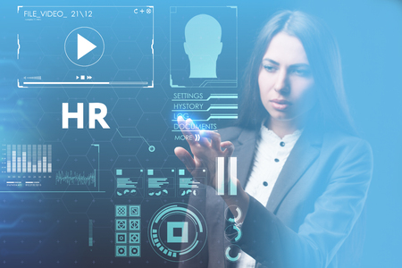 Photo for The concept of business, technology, the Internet and the network. A young entrepreneur working on a virtual screen of the future and sees the inscription: HR - Royalty Free Image