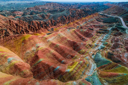 Photo pour Aerial view on the colorful rainbow mountains with amazing pattern in Zhangye danxia landform geological park in Gansu province, China. - image libre de droit