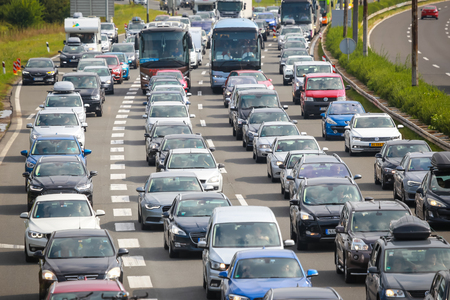 Foto de ZAGREB, CROATIA - August 11th, 2018 : Big traffic jam due to the large number of tourists going to the sea coast of Croatia in the Lucko highway toll in Zagreb, Croatia. - Imagen libre de derechos