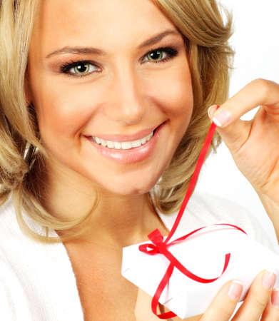 Beautiful female opening gift, closeup portrait isolated on white background