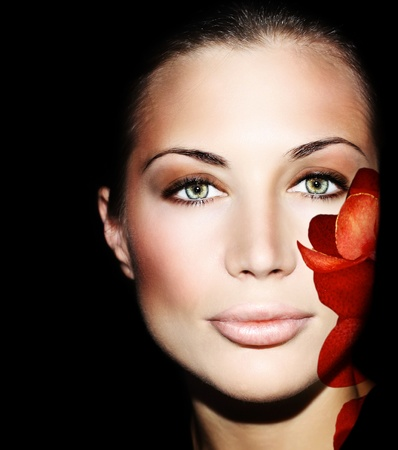 Beautiful female face with flower petals, conceptual image of skincare & youth