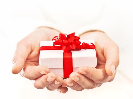 Photo for Hands holding beautiful gift box, female giving gift, christmas holidays and greeting season concept, shallow dof - Royalty Free Image
