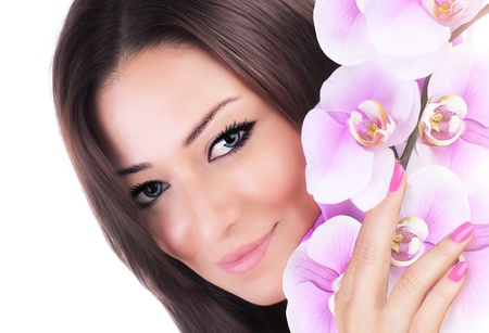 Beautiful female holding pink fresh orchid flower, sensual female portrait isolated on white background, girl with spring plant, spa skin care and beauty concept