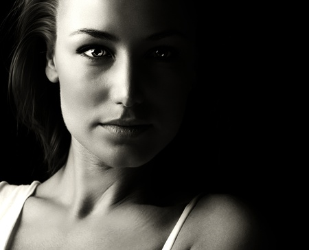 Black and white glamor woman portrait, dark beautiful face, female isolated on black