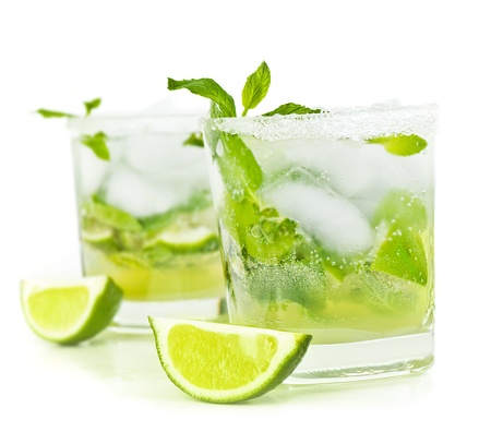 Cold mojito drink, glass of alcohol isolated over white background, fresh mint and lime fruit slice, food still life, party and holidays celebration