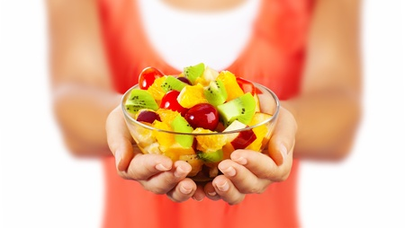 Foto per Healthy mix fruit salad, closeup on fresh summer dessert, woman holds lunch bowl, selective focus on female hands, eating girl shallow dof, body weight care, health and diet concept - Immagine Royalty Free