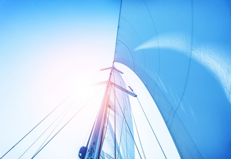 Photo pour Closeup on sail on blue sky background, active lifestyle, cruise of dream, extreme water sport, summer holidays, yachting concept - image libre de droit