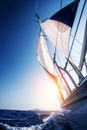 Photo pour Sail boat in action, summer adventure, luxury water transport, sunset light, active lifestyle, recreation in the sea, travel and tourism concept  - image libre de droit