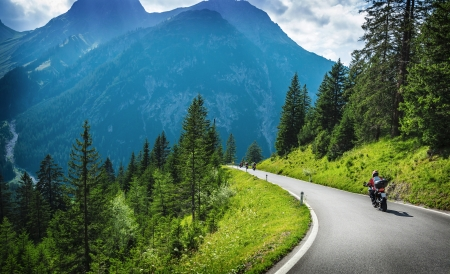 Photo for Motorcyclists in mountainous touring, extreme adventure, European journey, extreme road along Alps, active holiday concept - Royalty Free Image