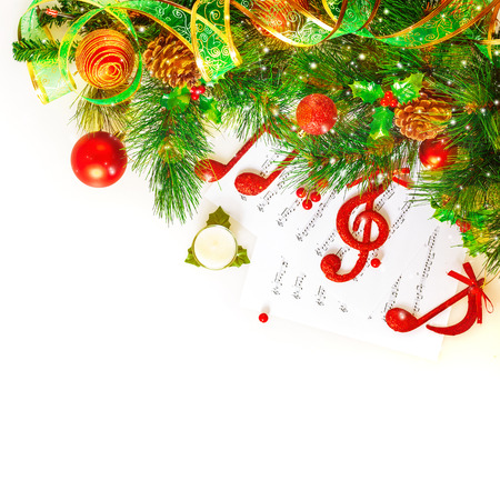 Photo pour Festive musical still life, red treble clef and notes decorated fresh green fir tree branch isolated on white background, Christmas holidays concept  - image libre de droit