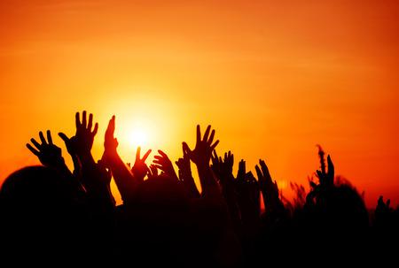 Photo pour silhouettes of hands up in the sky - image libre de droit