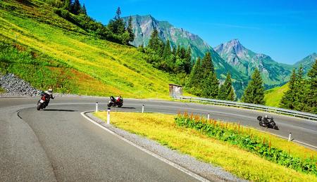 Photo pour Motorbikers group in mountainous tour, active lifestyle, summertime adventure, extreme sport, speed concept - image libre de droit