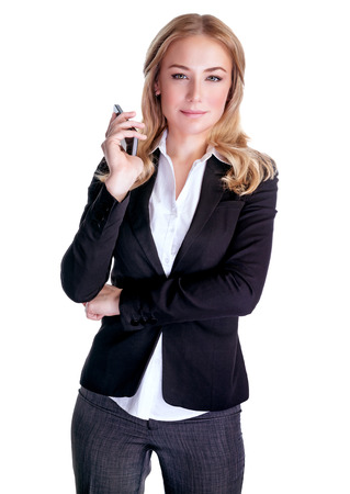 Foto de Portrait of young serious female speaking on mobile phone, isolated on white background, business people using portable device, communication concept  - Imagen libre de derechos
