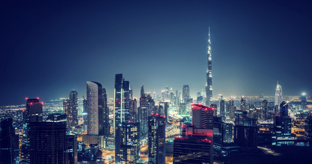 Photo pour Beautiful Dubai cityscape, bird's eye view on a night urban scene, modern city panoramic landscape, United Arab Emirates - image libre de droit