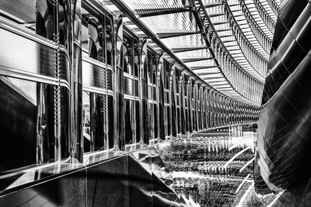 Foto de Beautiful modern interior of office building, abstract black and white background, stylish contemporary steel contraction - Imagen libre de derechos