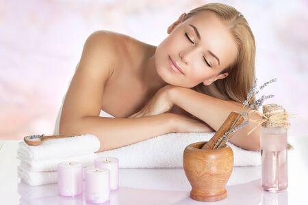 Photo for Portrait of a beautiful calm woman sleeping on massage table, closing eyes of pleasure, enjoying medical and beauty procedure, day spa concept - Royalty Free Image
