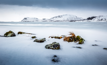 Photo pour Beautiful winter landscape, amazing view on the frozen lake covered with white clean snow, cold but wonderful weather, Iceland, Scandinavia  - image libre de droit