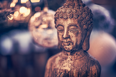 Photo pour Vintage style photo of the wooden statue of Buddha, God of oriental religion, conceptual picture of meditation, mindfulness and inner peace - image libre de droit