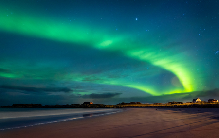 Photo for Northern lights, beautiful landscape of a green light in the night starry sky, amazing natural beauty of Lofoten archipelago, Gimsoya, Norway - Royalty Free Image