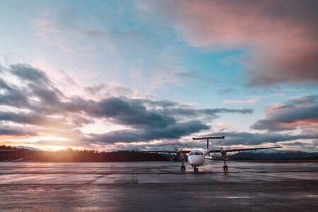 Foto de Airplane in sunset light, beautiful cloudy sky, luxury transport, travel to Norway, Scandinavia, North Europe  - Imagen libre de derechos