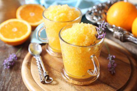 Photo for Orange granita, frozen summer dessert and  blooming lavender dressing, selective focus - Royalty Free Image