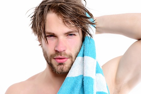 Photo pour Strength and sportive shape idea. Macho with striped towel and big muscles isolated on white background. Bearded man with naked body and confident face wipes his hair. Shower time and sports concept - image libre de droit