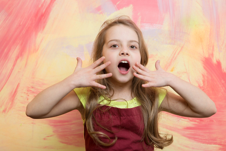 Photo for Girl cook with open mouth on surprised face posing in red chef apron on colorful abstract wall. Child and childhood. Cooking concept - Royalty Free Image