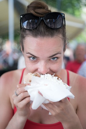 Foto de pretty girl or Woman eating sandwich gyros. Girl with pleasure eats burger after diet. She opened her mouth, holding a gyros on his outstretched hands and closed her eyes. - Imagen libre de derechos