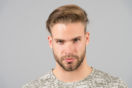 Foto de Man bearded confident face, grey background. Skin care concept. Man bearded unshaven guy looks handsome and well groomed. Guy attractive cares about his appearance. Macho with smooth healthy skin - Imagen libre de derechos