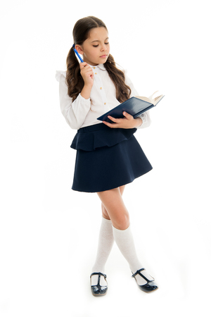 Foto de Schoolgirl read book isolated on white. Little child hold textbook with pen. Dedicated to study. Back to school. Home schooling education. Knowledge day. Adorable bookworm. Back to school - Imagen libre de derechos