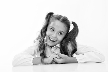 Photo for Perfect schoolgirl with tidy fancy hair. School hairstyle ultimate top list. Prepare kid first school day. Schoolgirl happy carefree face cute ponytail. Excellent pupil lean on desk isolated white. - Royalty Free Image