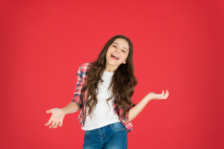 Photo pour Lets have fun. Come on. Carefree and joyful. Kid girl carefree expression. I do not know. Take it easy. Child with long curly hair feeling cheerful and carefree. Happy childhood. Fun and relax. - image libre de droit