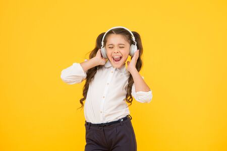 Photo for Child enjoy music sound. Audio schooling. Home schooling. Small girl pupil headphones. Child happy listen music. Audio book. Education and fun concept. Online schooling. Listening lesson. Sing song - Royalty Free Image