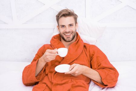 Photo for Enjoy morning coffee. Happy morning. Handsome man drink morning coffee. Happy bearded man in bed. Good mood. Starting day with good coffee. Relaxing at home. Pleasant moments. Gourmet espresso - Royalty Free Image
