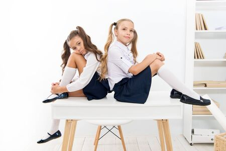 Photo pour Informal and formal knowledge. Cute little schoolgirls having lesson on Knowledge day. Small children celebrating day of knowledge on September 1. Getting knowledge and skills at school - image libre de droit