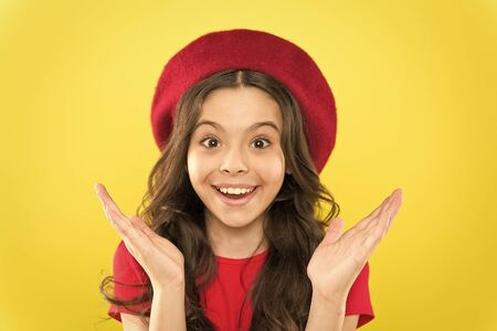 Foto de Smiling cutie. Small child with cheerful smiling face on yellow background. Little girl happy smiling with beauty look. Adorable beauty model with cute smile. Im always smiling and happy - Imagen libre de derechos