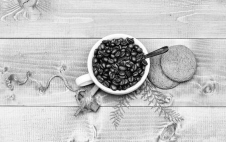 Foto de Fresh roasted coffee beans. Cup full coffee brown roasted bean blue wooden background. Caffeine concept. Cafe drinks menu. Arabica robusta coffee variety. Beverage for inspiration and energy charge. - Imagen libre de derechos