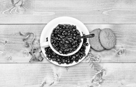 Foto de Cafe drinks menu. Arabica robusta coffee variety. Beverage for inspiration and energy charge. Fresh roasted coffee beans. Cup full coffee brown roasted bean blue wooden background. Caffeine concept - Imagen libre de derechos